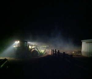 Miles working in the tractor in the middle of the night.